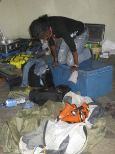 Videojournalist Jolie Okako delicately packs for the expedition to Lomako.