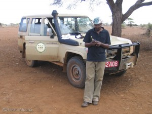 "Here I am in ""the Dusty Heartland"" working with a GPS unit."