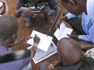 Rashid goes over mapping with the scout trainees.