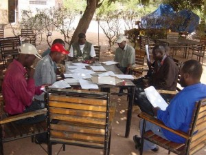 Gettin' down to business: AWF's Zambezi Heartland team, headed up by 2006-2007 Charlotte Conservation fellow Jimmiel Mandima (seated in red cap) in a planning session. (Photo Credit ©: African Wildlife Foundation)